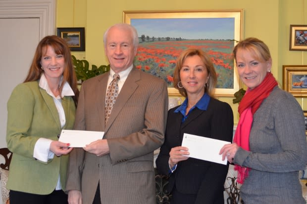 From left: Fairfield Christmas Tree Festival President Moira Rachel, presents cheks Terry O'Connor of the Cardinal Shehan Center and Donna Twist of the Norma F. Pfriem Breast Care Center and with Colleen Murphy, FCTF Vice-President.
