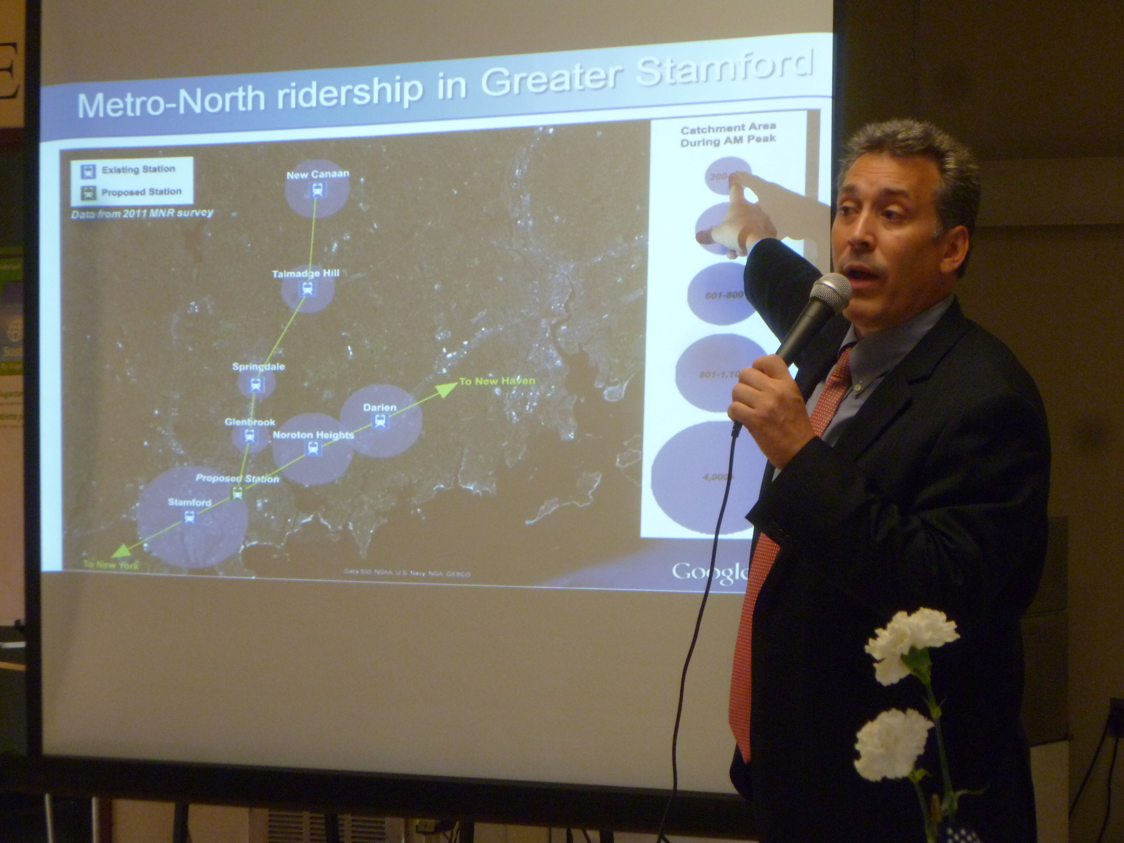 Thomas Jost of Parsons Brinckerhoff explains some of the different train station options for Stamford's East Side during one of the first public meetings for the study.