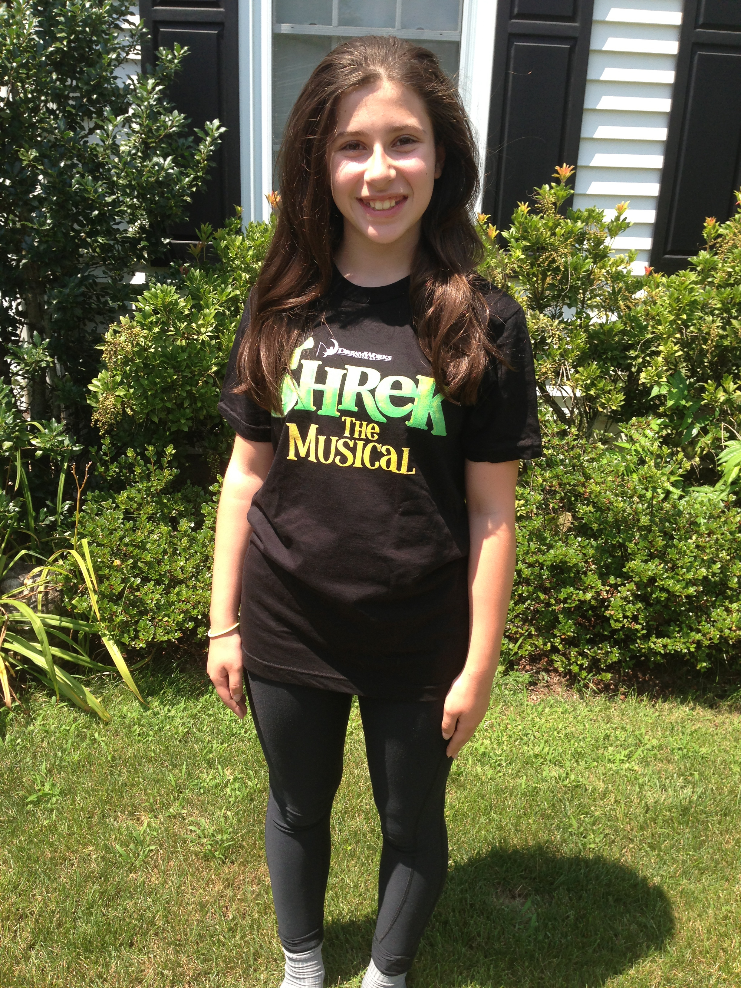 """Isabella Salant of New Canaan wears her """"Shrek The Musical"""" t-shirt, a production she will be acting in along with two others from town."""
