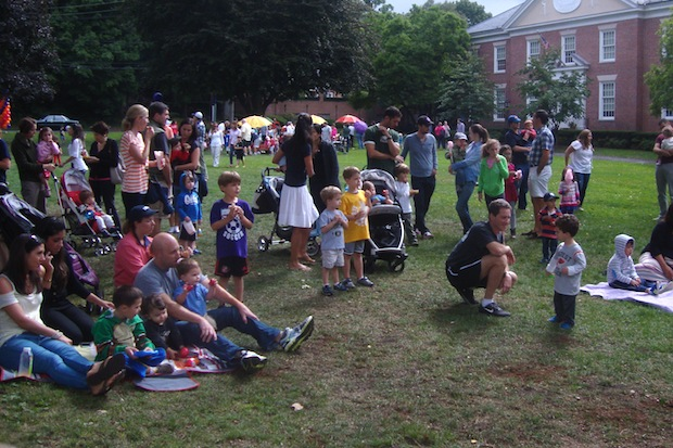Families congregate on the village green for the 100th birthday party for the Rye Free Reading Room.