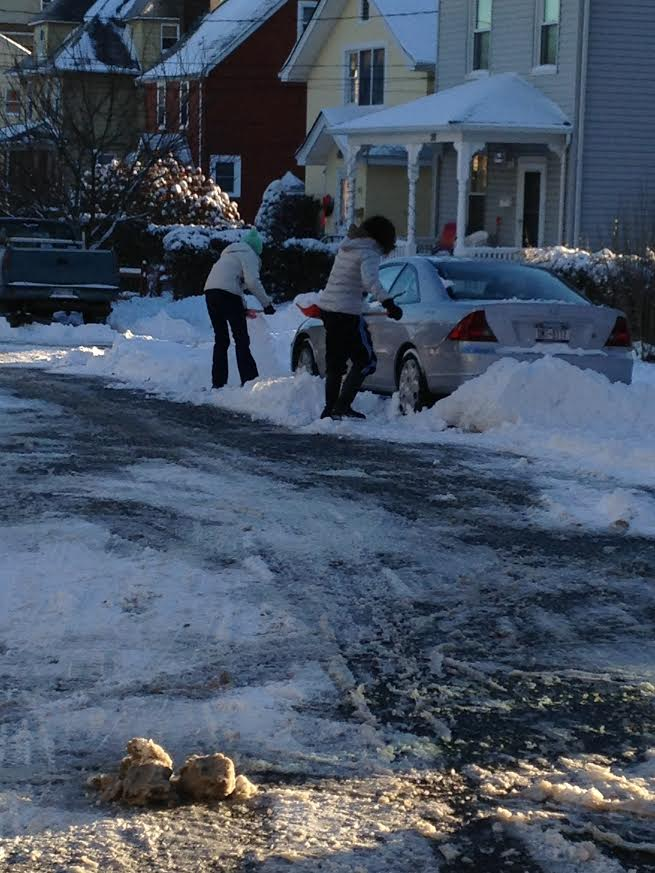 Jordan Levy and her mother Elaine shoveling out their car on Saturday.