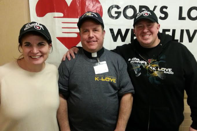 Bronxville Village Lutheran Church's Vicar Morris Mayer poses with alongside Scott & Kelli of KLove radio after volunteering at a Brooklyn soup kitchen.