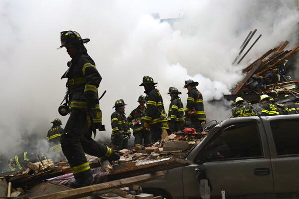 Fire crews survey the wreckage of a building in Harlem that was destroyed in an explosion on Wednesday.