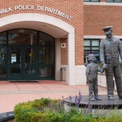 Norwalk police charged a man with making threatening remarks about his wife.