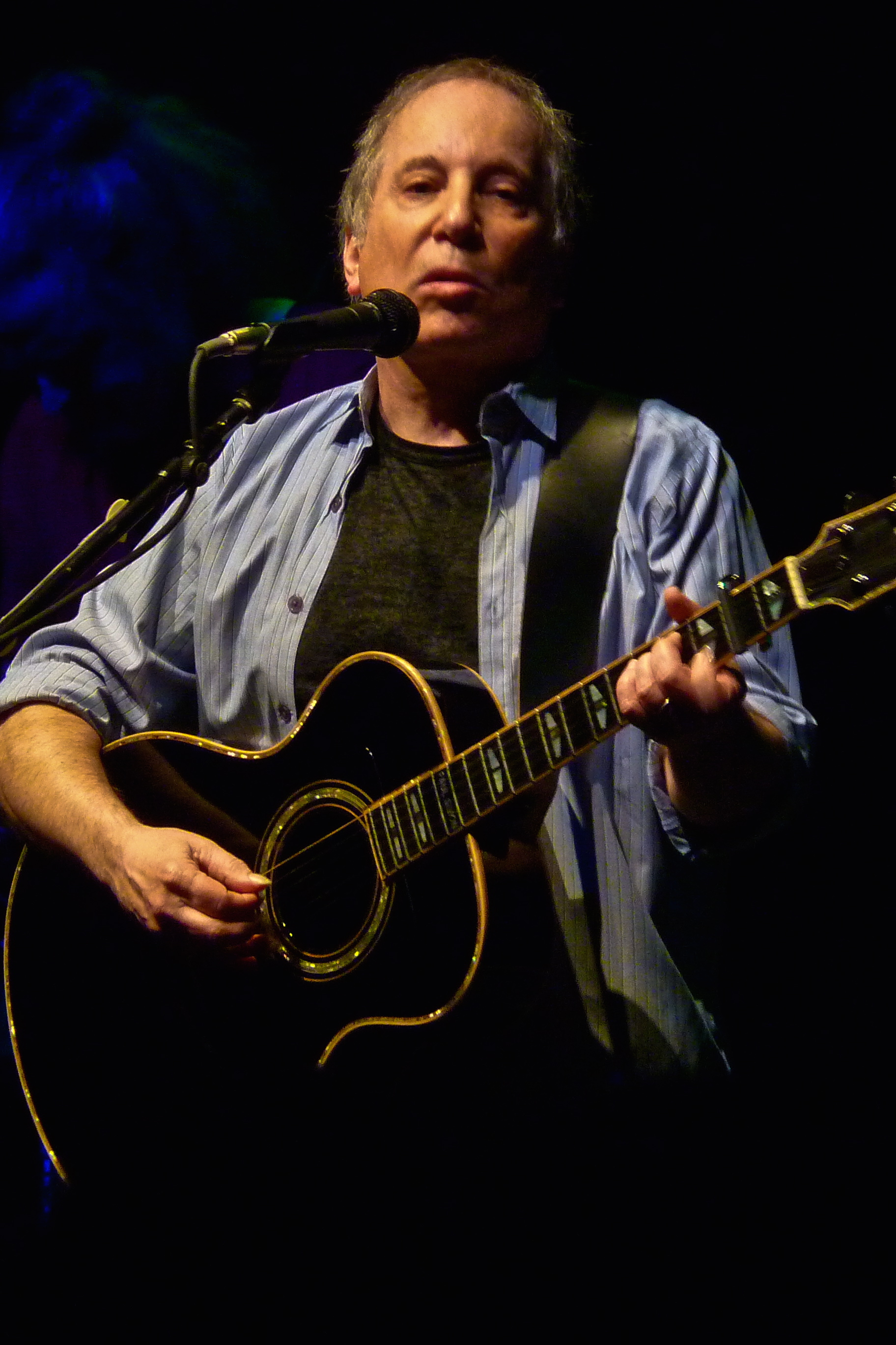 Folk singer Paul Simon is facing domestic charges after he and his wife were arrested in their New Canaan home over the weekend.