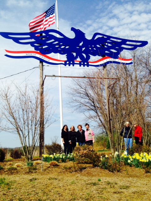 Armonk's eagle committee poses with the refurbished town eagle.