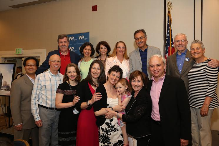 Rebecca Schmidt poses with members of the White Plains Hospital leadership and medical team who cared for her at their 2014 Cancer Survivor's Day celebration at the Crowne Plaza Hotel.