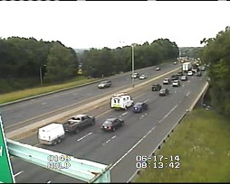 Traffic continues to flow on westbound I-84 in Danbury after a tractor-trailer spilled its load.