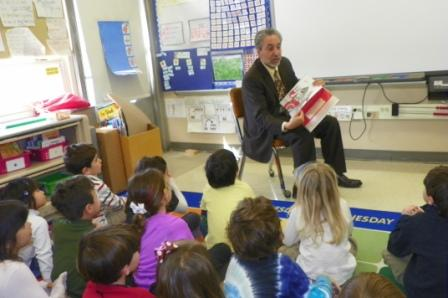 Harrison Schools Superintendent Louis Wool reads to students at Harrison Avenue Elementary School.