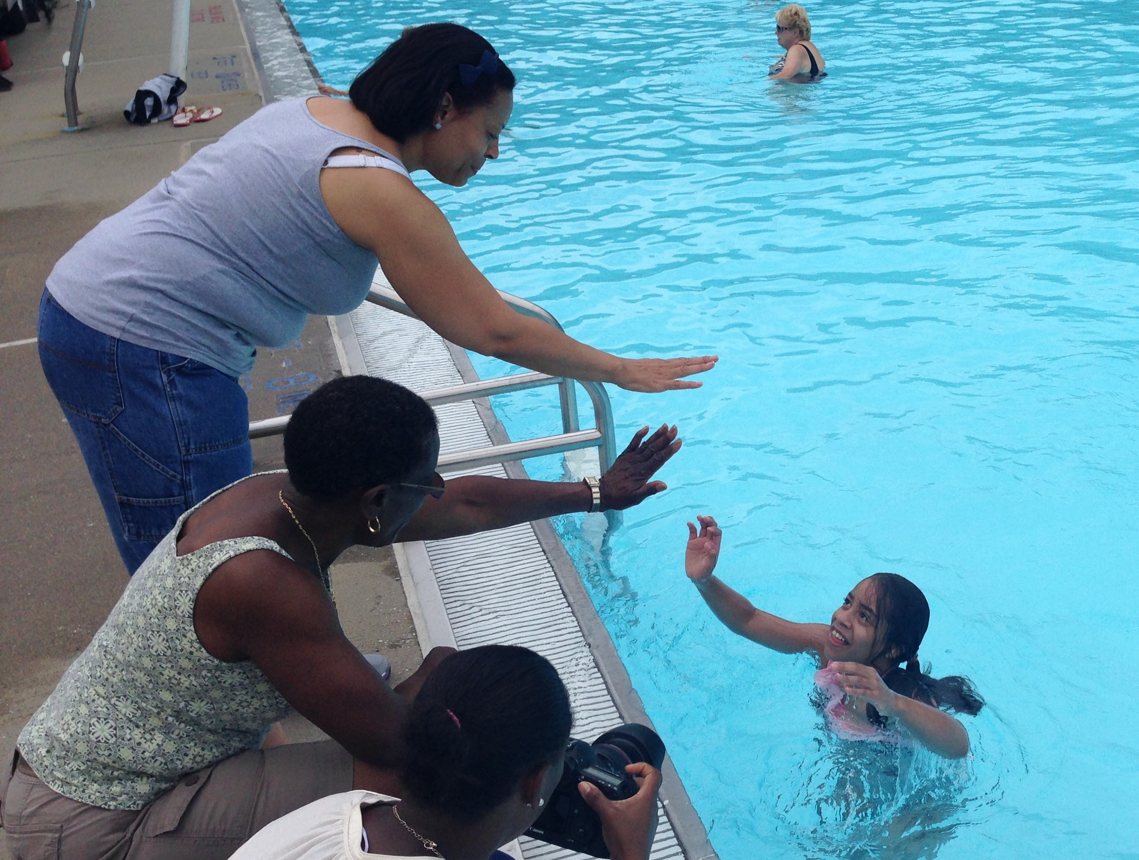 """Marisol """"Madi"""" Mallory, of Peekskill, high-fives her mother, Kimmy (left), and grandmother, Patricia Mallory-Smith (center)."""