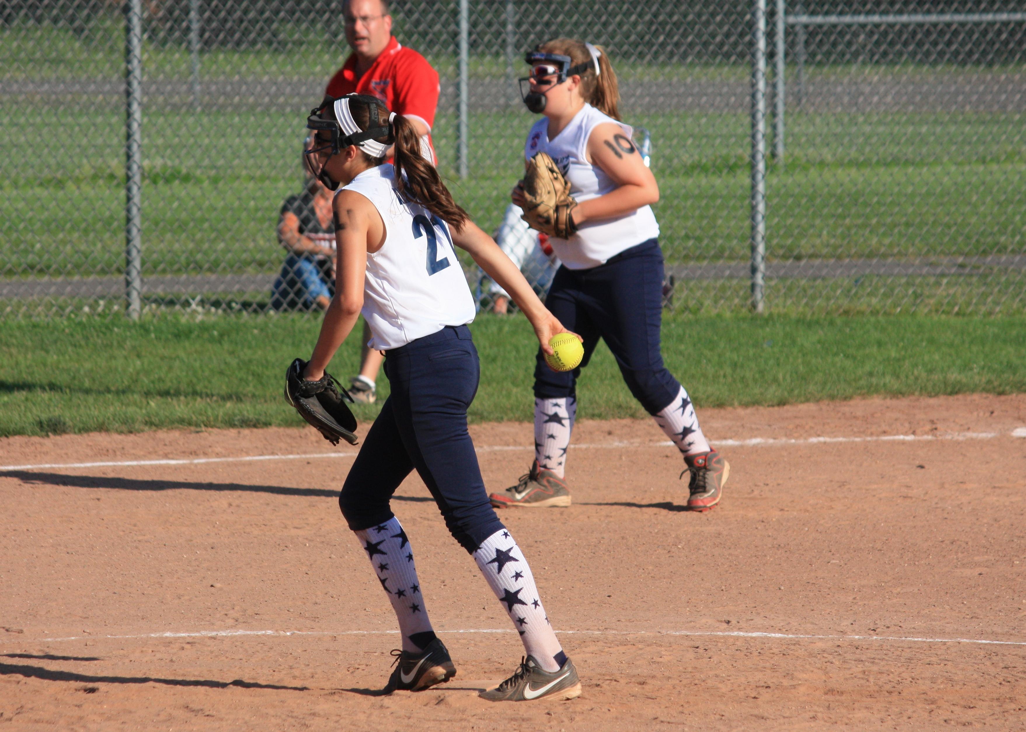 Sofia Alfero pitches for Westport and Emily Stone plays third base.