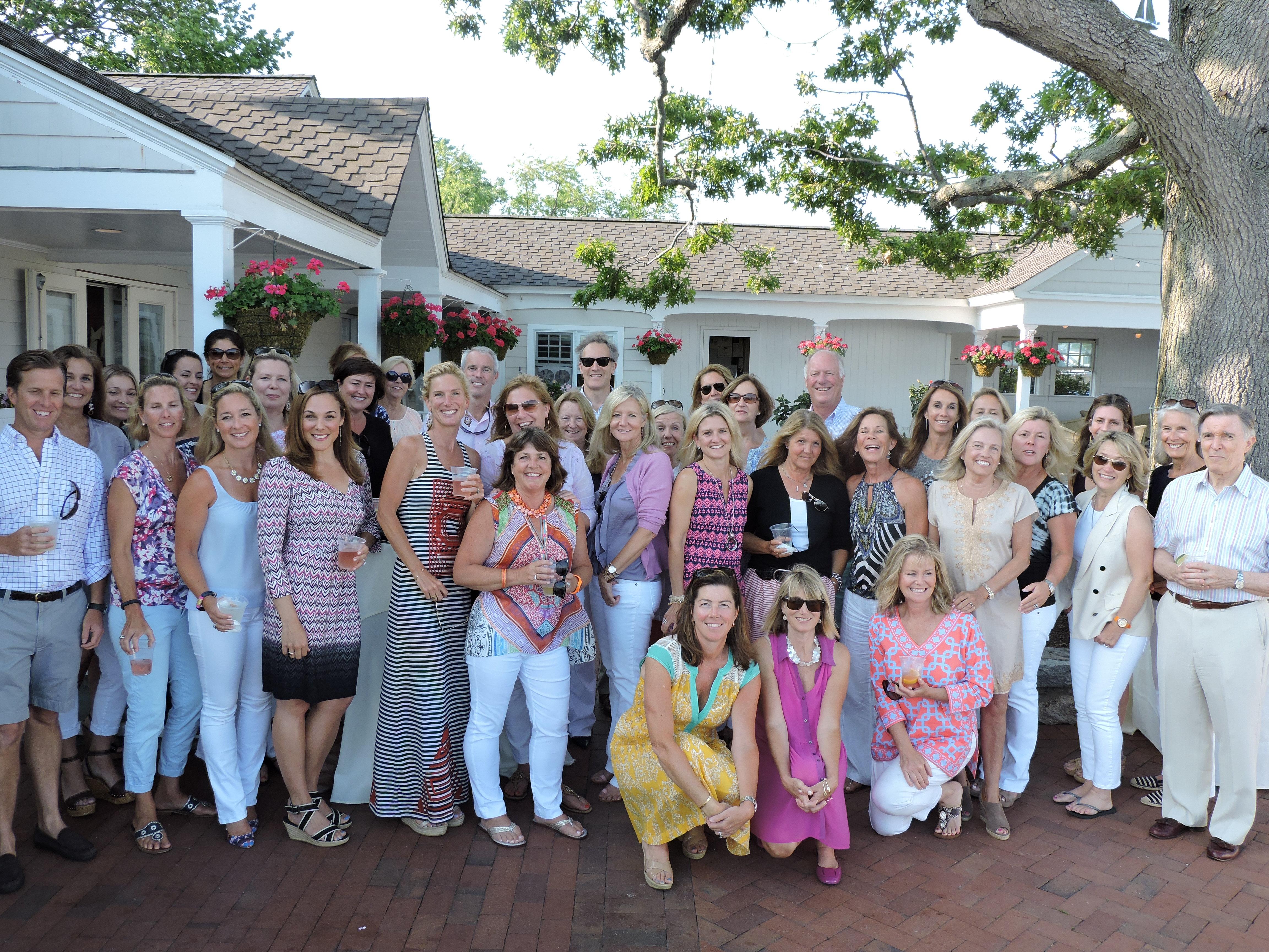 Kelly Associates celebrate real estate success at Darien's Wee Burn Beach Club.