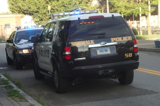 Richard DiPasquale, 54, of Norwalk was charged with threatening and breach of peace after police said he barricaded himself in a bedroom Thursday night.