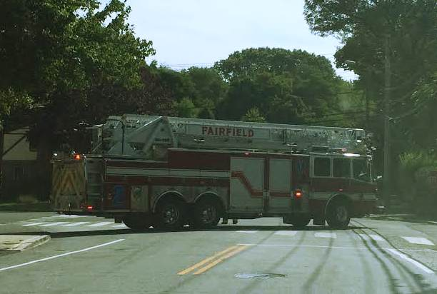 Fairfield police officers and fire fighters worked together to begin investigating a car accident turned car fire.