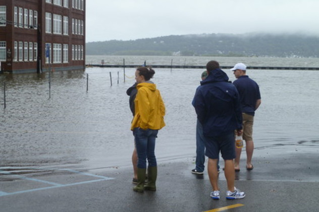 Irvington residents look at flooding in the Bridge Street parking lot after Hurricane Irene caused the Hudson River to overflow.