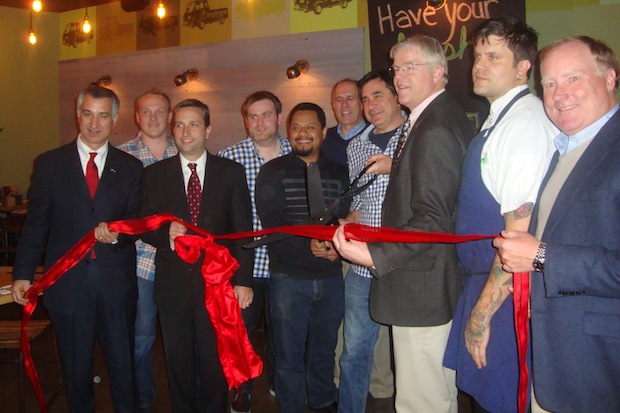 The owners of Bodega Taco Bar and members of the Darien Chamber of Commerce celebrate the opening of the new restaurant with a ribbon cutting.