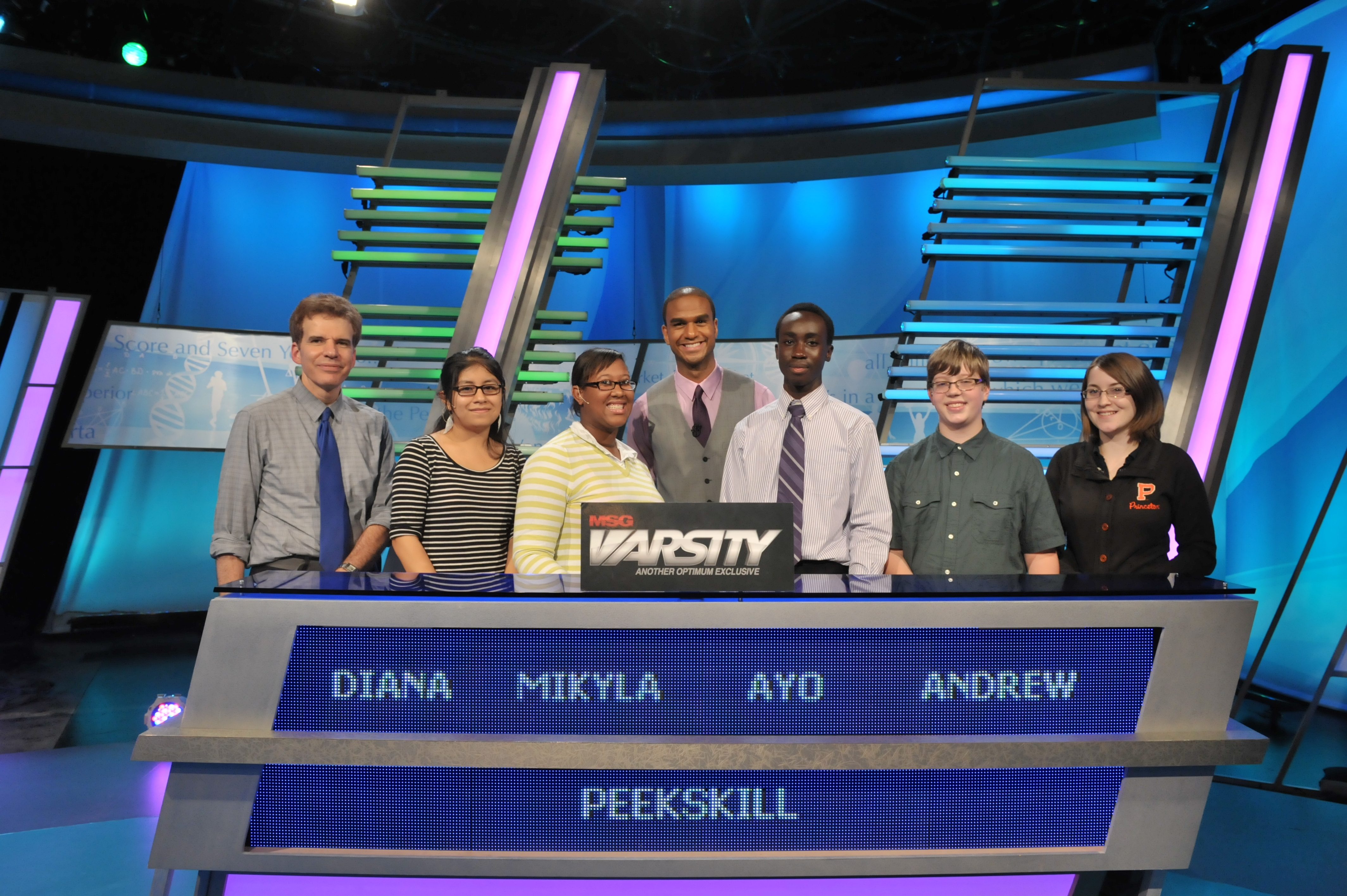 "The Peekskill students competing on ""The Challenge,"" are Diana Barreto, Mikyla Abdul-Azim (captain), Ayomide Jegeded, Andrew Wise and Toluwanimi Jegede. At left is academic adviser Greg Erickson and in center is ""The Challenge"" host Jared Cotter."