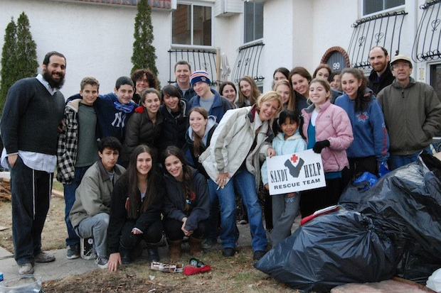 Students and faculty members of Solomon Schechter's Disaster Relief Club gather for a photo in Long Island on Sunday, where they assisted families in rebuilding homes damaged by Hurricane Sandy.