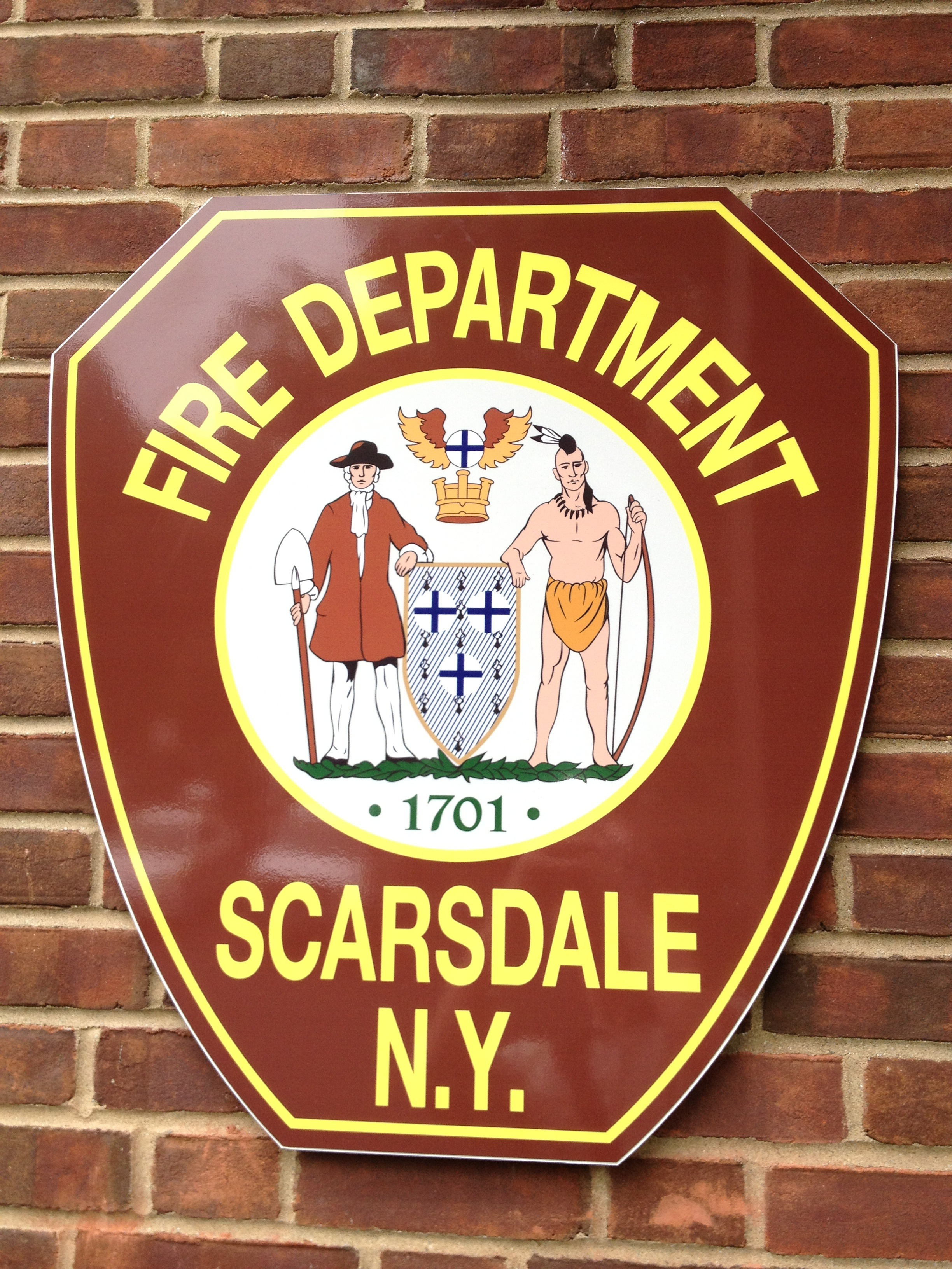 Scarsdale firefighters extinguished smoldering coals in a grill Friday.