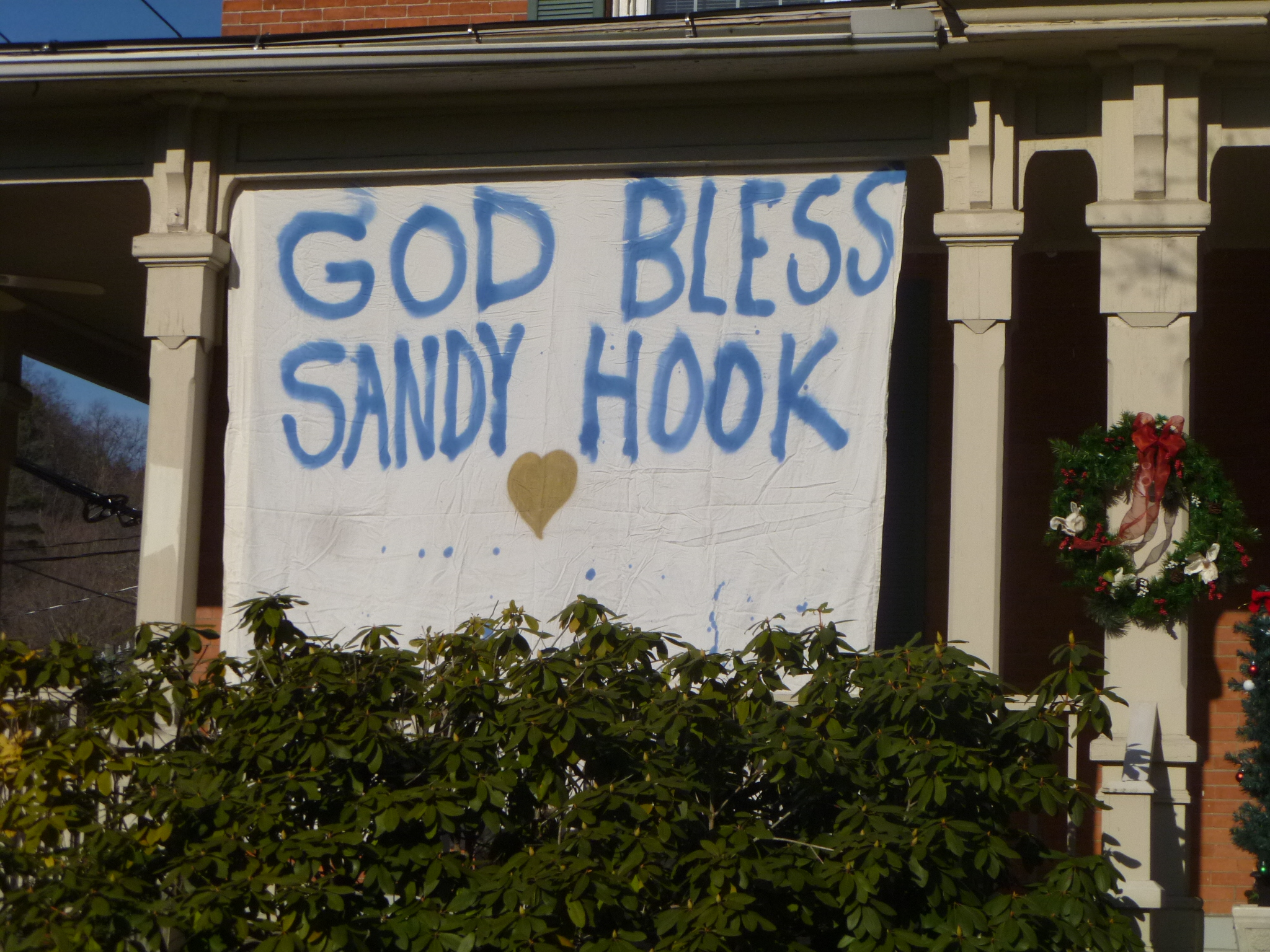 Sign posted in Sandy Hook center Saturday expresses remorse for the mass slayings at Sandy Hook School.