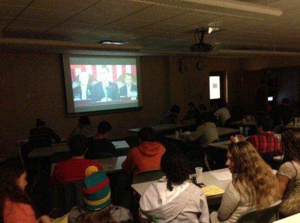 Mamaroneck High School seniors watch Tuesday night's State of the Union Address together in a classroom.