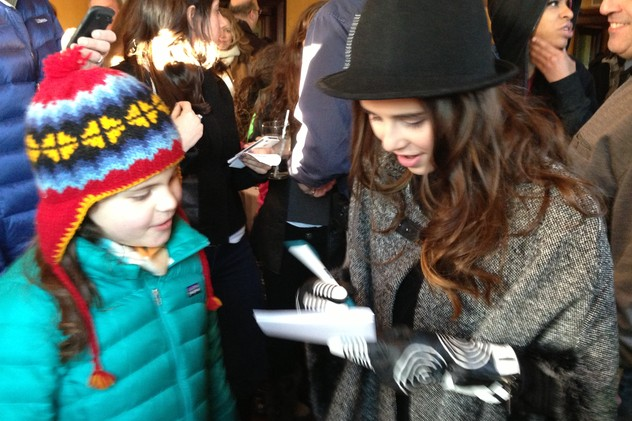 Carly Rose Sonenclar signs an autograph for a young fan at a Mamaroneck party in her honor.