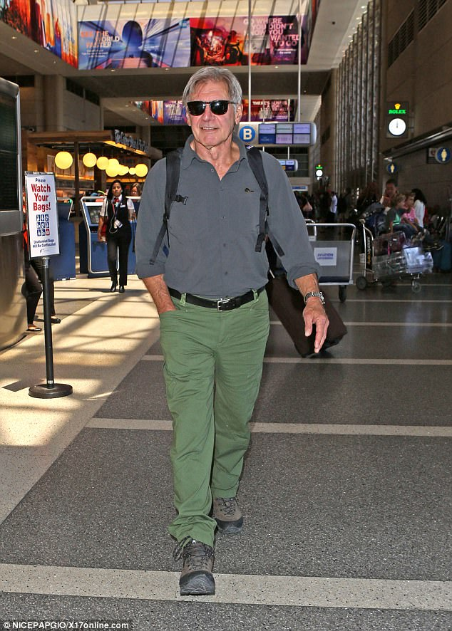 Family getaway: Harrison Ford led his wife Calista Flockhart and adopted son Liam across the concourse at LAX ready to jet away for a break