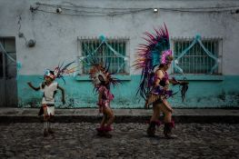 A group of pre-Hispanic dancers take part in a procession for Our Lady of the Rosary in Ajijic, Jalisco, Mexico. Aztec dancers often form an essential part of important Catholic processions 500 years after the Spanish first arrived to conquer the country.