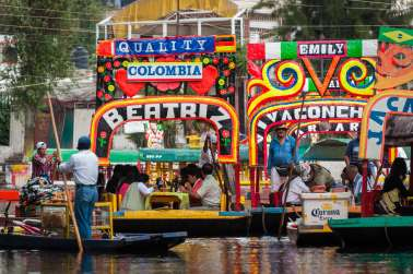 Colorful trajineras at the Xochimilco floating gardens in southern Mexico City.