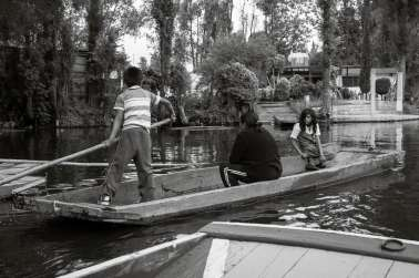 A girl commuting to school by boat at Xochimilco.