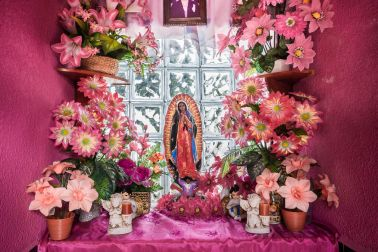 A pink altar in a mausoleum with the Virgin of Guadalupe