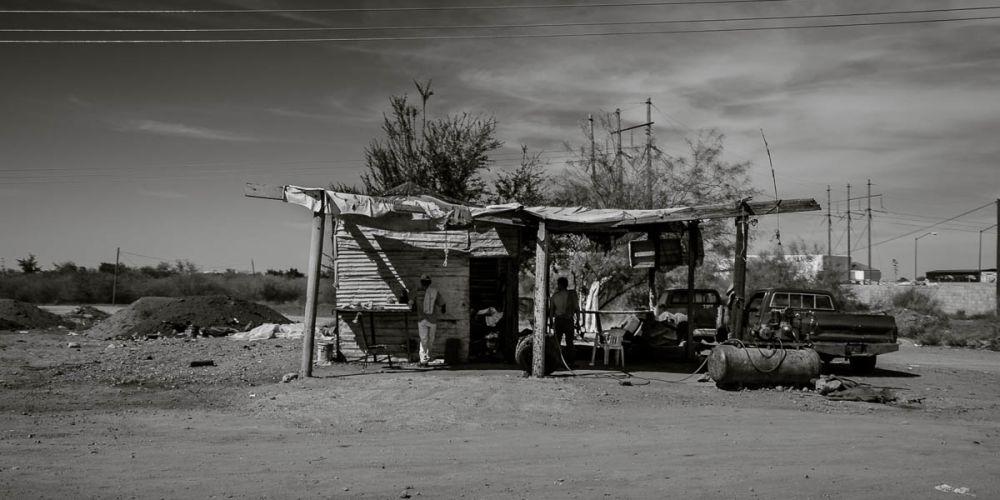 Highway 15 photo of men in a workshop.
