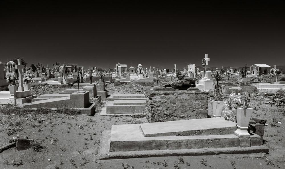 A graveyard by the freeway passing through Estación Llano, Sonora, Mexico.