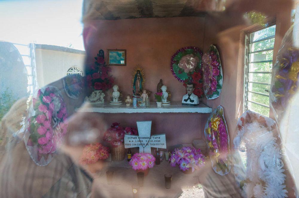 Jesús Malverde bust on a grave in Sinaloa, Mexico.