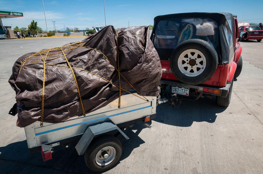 On the road moving to Mexico in a Suzuki Samurai.