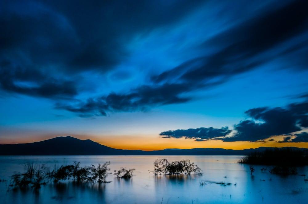 Landscape photo of a blue-colored sunset at Lake Chapala.