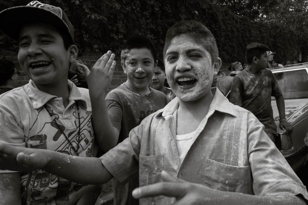 A boy after getting attacked with flour by a zayaca.