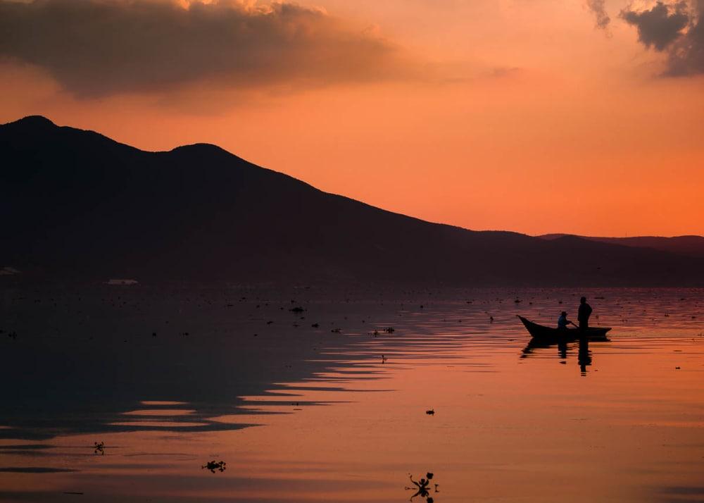 Boat and reflection on Lake Chapala, Mexico