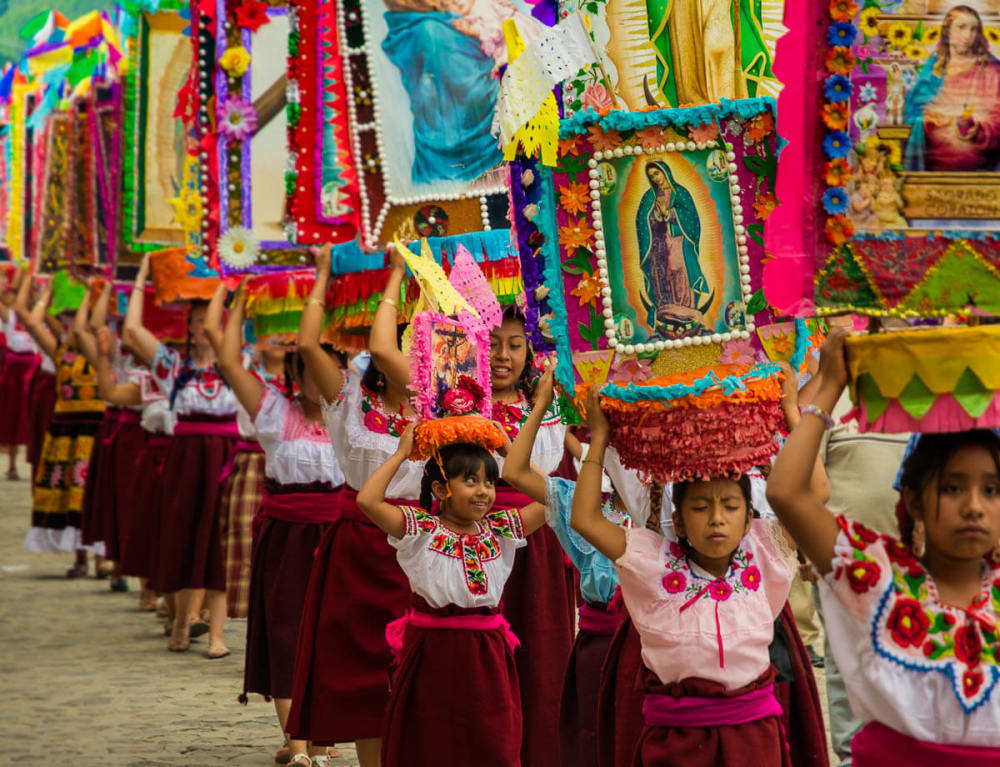Women taking part in a procession in Teotitlán del Valle, Oaxaca, Mexico