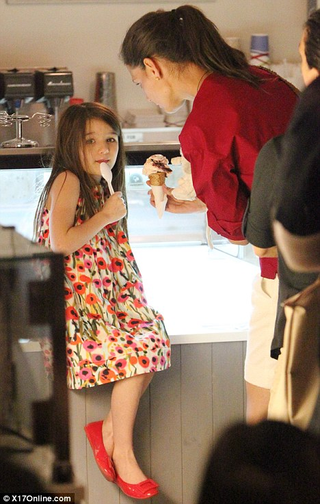 Yummy: Katie took her daughter Suri out for the first time yesterday since the shock announcement on Friday
