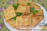 Фото к рецепту: Жареный лаваш с колбасой и сыром