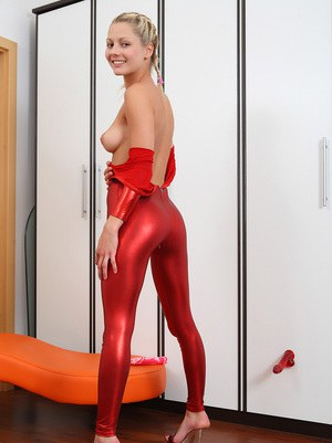 Young blonde Pinky June pulls down Zentai outfit before masturbating