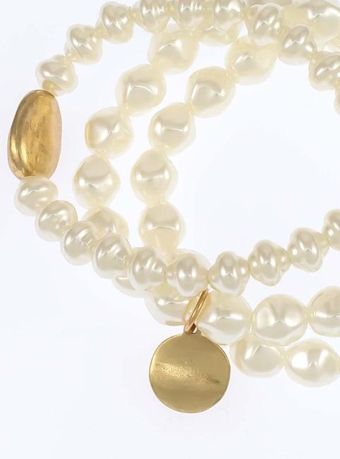 Carol Dauplaise Three strand pearl stretch Bracelet