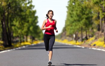 Woman running,street,shade,trees