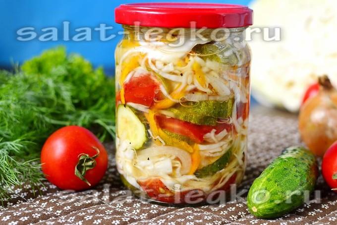 Салат на зиму из огурцов и помидор с капустой