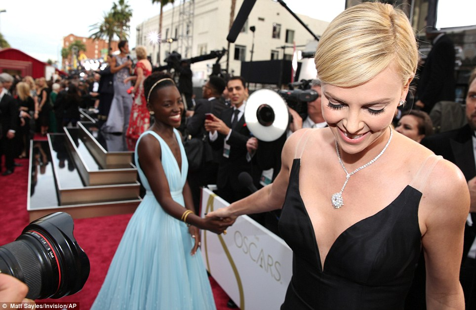 Fancy seeing you here: Charlize greeted Lupita during press interviews