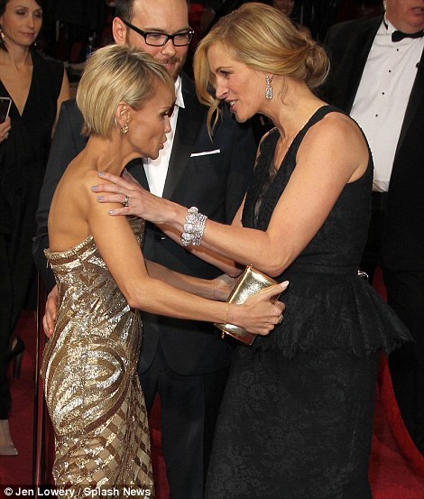 Glamorous embraces: Julia Roberts says 'hello' to Kristin Chenoweth and Jennifer Lawrence greeted Cate Blanchett