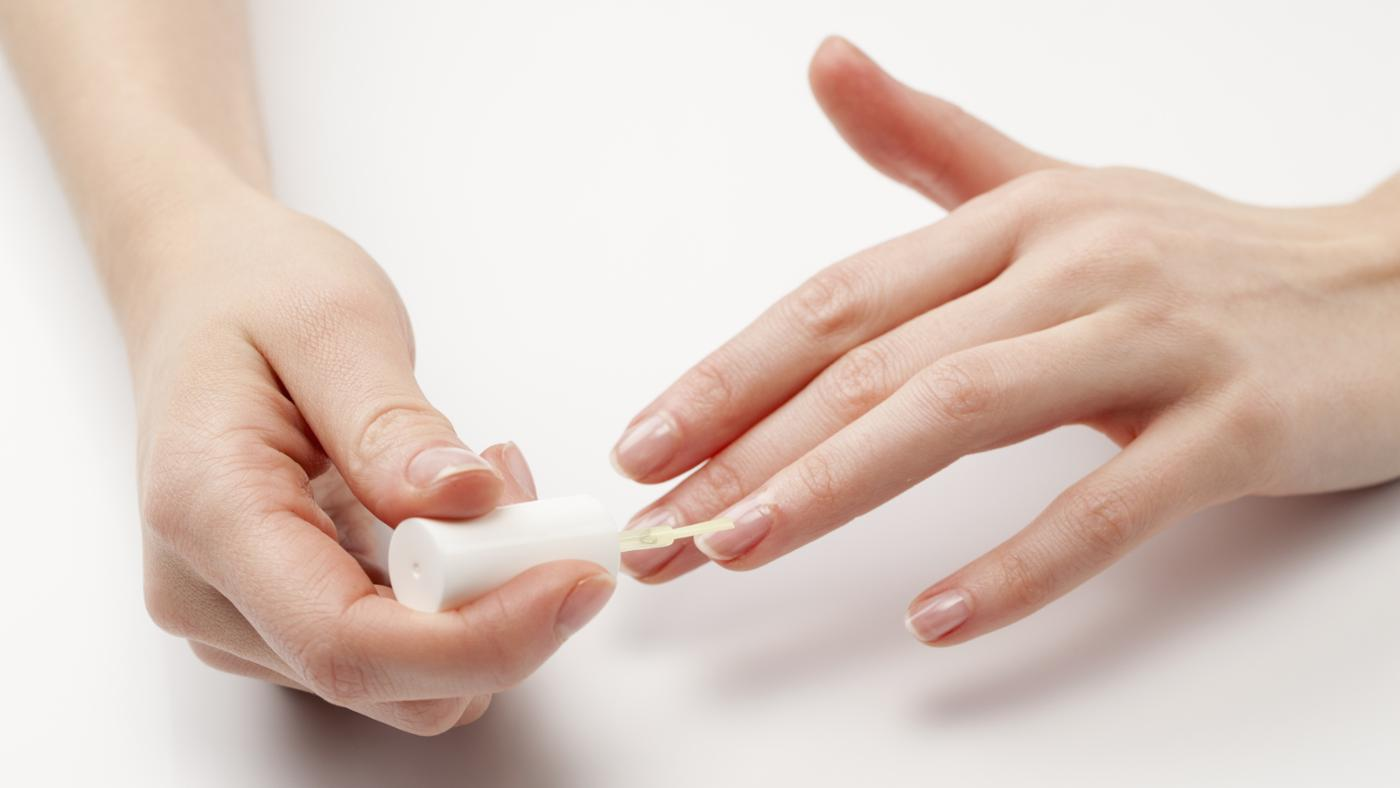 What causes black lines in your fingernails