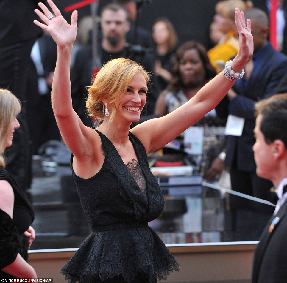 Pleased to be here! The August: Osage County actress greeted fans who cheered as she walked the carpet