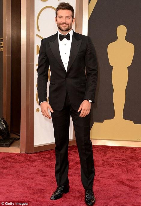 Dapper: Bradley Cooper and Zac Efron dressed to impress in dark suits